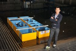 Dr Zhao with a side-by-side model in wave basin