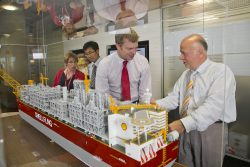 Shell EMI Chair visiting the FLNG model in Shell office (Jan Flynn, Wenhua Zhao, David White and Mike Efthymiou)