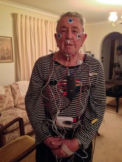 Volunteer Ian Murray wearing a home-based polysomnography device which measures sleep and breathing.